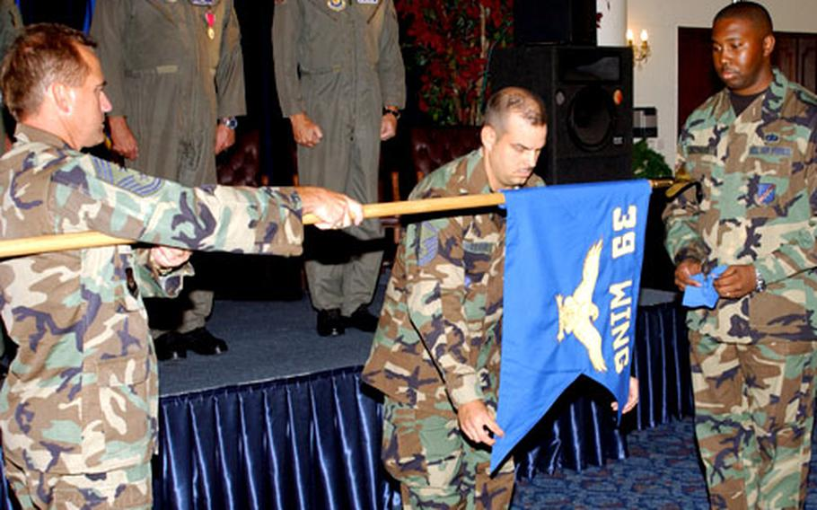 Command Chief Master Sgt. William Kennedy, left, Master Sgt. Randall Veltri, center, and Staff Sgt. Cedric Shephard case the 39th Wing flag during a ceremony at Incirlik on Monday.