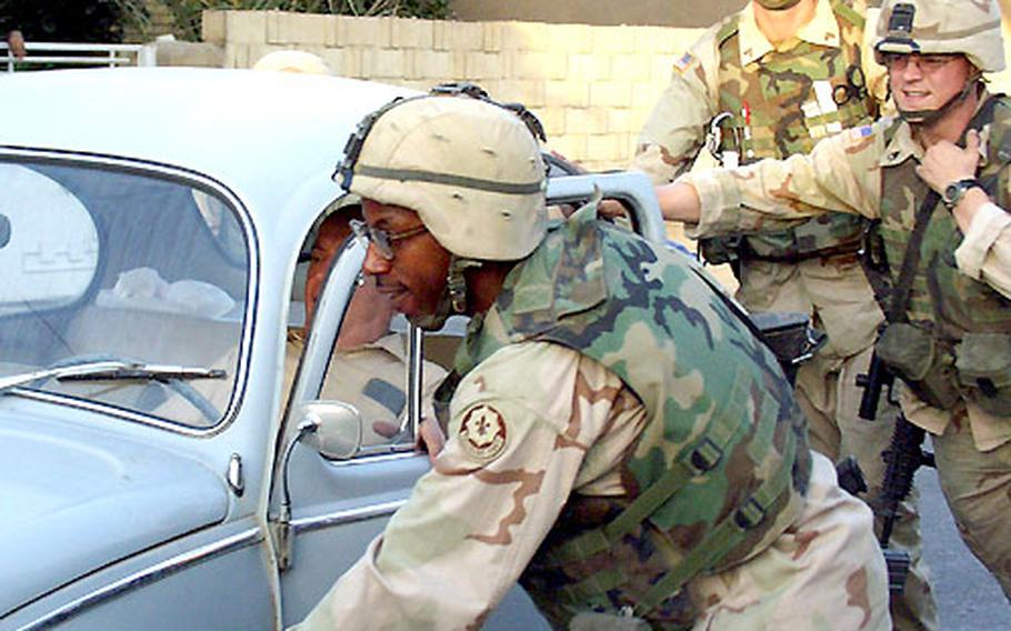 Spc. Anthony Adams and the rest of the patrol provide a push to an elderly Iraqi man who's Volkswagen Beetle wouldn't start Wednesday. Scouts from the 2nd Armored Cavalry Regiment spent hours checking out the neighborhoods in east Baghdad that they're responsible for — and they got the car started, too.