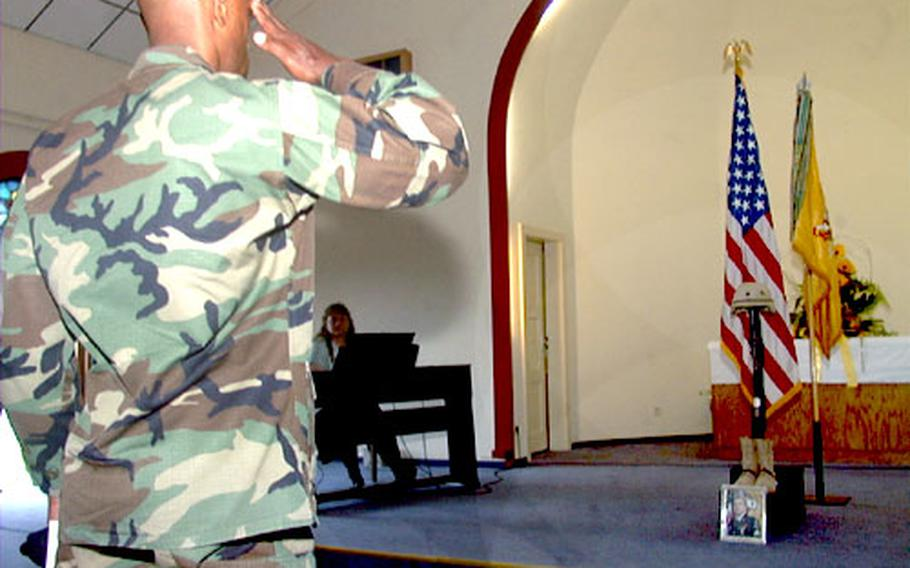 A solider offers a salute to Army Sgt. David B. Parson. A memorial service for Parson, shot and killed in Iraq on July 6, was held Wednesday morning at the chapel on Ray Barracks in Friedberg, Germany.