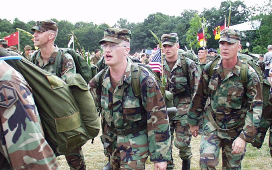 Members of the 2nd Military Intelligence Battalion from Darmstadt, Germany, arrive Friday at the finish of the 87th annual Four Days Marches in Nijmegen, Netherlands.