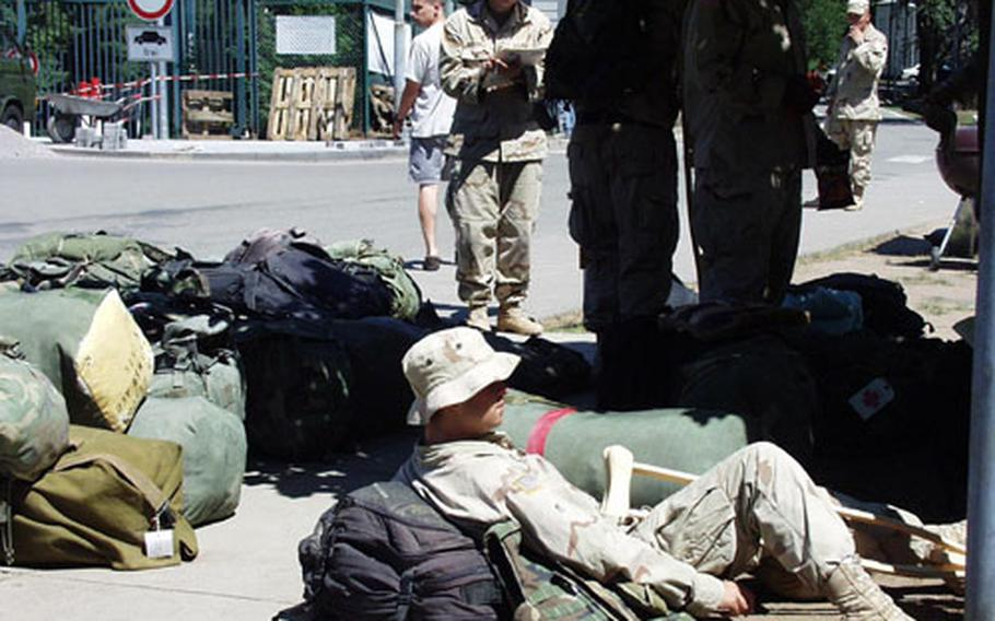 Soldiers wait outside Landstuhl Regional Medical Center's Deployed Warrior Medical Management Center in Germany. The hospital is receiving more patients from Iraq now than it did during the major combat phase.