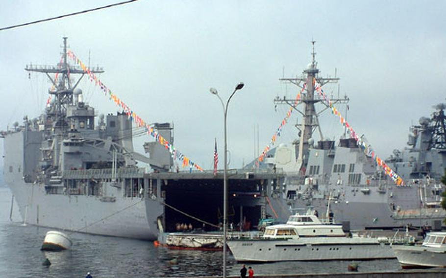 The USS Fort McHenry and the USS Lassen are shown in port at Vladivostok, Russia.