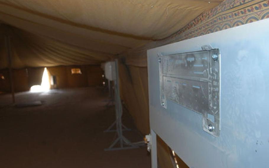The mount for an air conditioner sits empty after a previous tenant at Camp Virginia, Kuwait, made off with it.