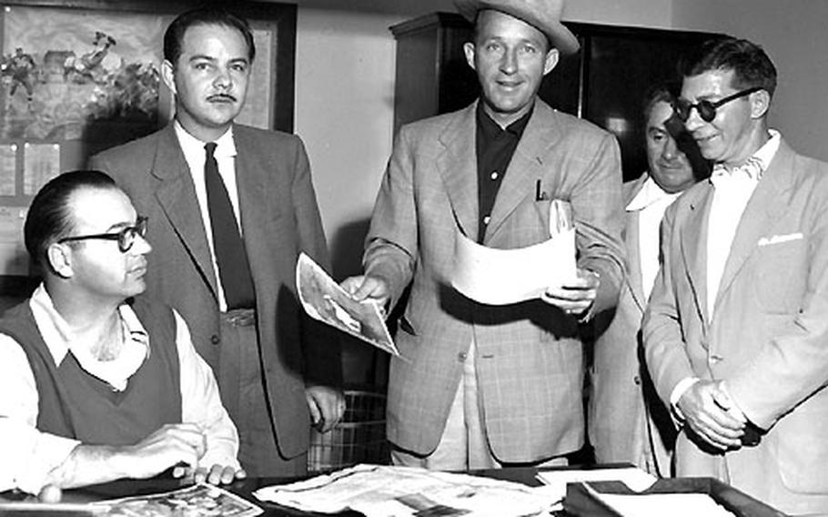 Bing Crosby visits the Stars and Stripes newsroom in Darmstadt, Germany, in 1953. Left to right: Sports editor Jack Ellis, editor Ken Zumwalt, Crosby, and staffers John Livingood and Ernie Reed.