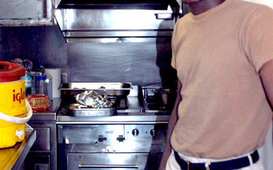Spc. Frederick A. Hull is the tug's cook.