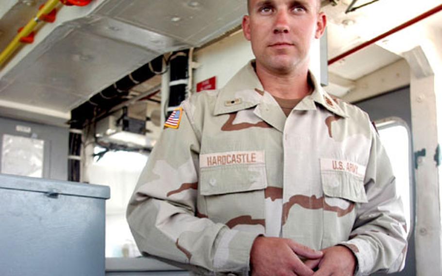 Warrant Officer 1 Eric Hardcastle, navigational officer of the Champagne Marne, stands on the bridge.