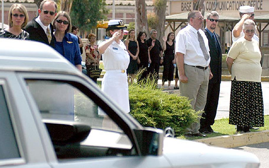 After the memorial service, dozens of friends and family lined the Sigonella base street to observe cars carrying the four sailors' remains driving past.