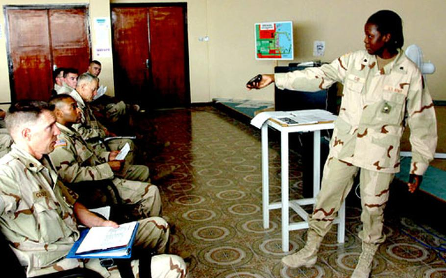 Spc. Suzan Oliver teaches counting in Arabic to her class at the Port Authority building at Shuaiba Port, Kuwait. Oliver speaks seven dialects of Arabic.