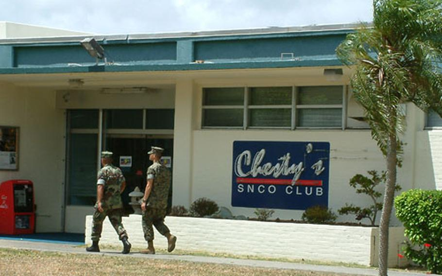 Two Marines enter Chesty's Senior Non-Commissioned Officer's club on Tuesday, July 22 at Camp Foster. The club won an award for best large SNCO club in the Marine Corps.
