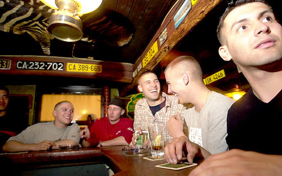 Soldiers from Schweinfurt, Germany, share laughs and a few drinks Friday night at Kyalami, a longtime popular hangout in the Sachsenhausen pub district of Frankfurt, Germany. An exhausted Spc. Clint Lamebear was falling alseep at the bar in Kyalami the night he was murdered last November.