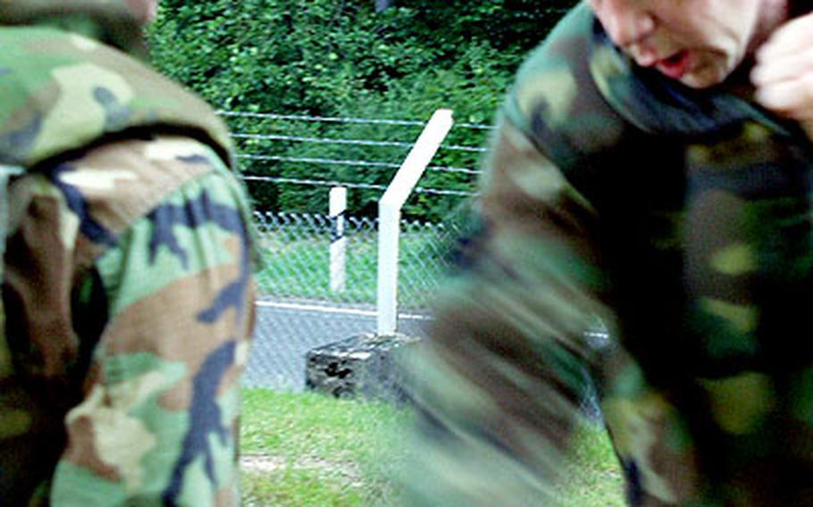 A Marine assigned to Marine Forces Europe Headquarters in Germany wields a plastic knife against his training partner.