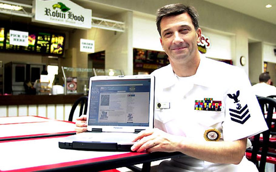 Petty Officer 1st Class James Little uses his laptop computer in the Navy Exchange Food Court at Atsugi Naval Air Facilityi. A high-speed wireless internet service was recently added to the food court and other buildings around the installation.