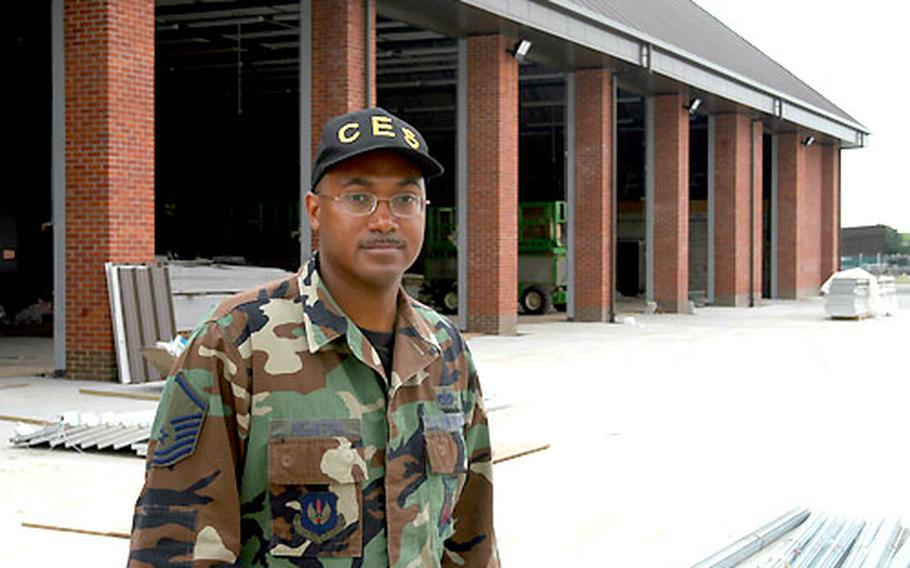 Master Sgt. Reco Houston, an assistant fire chief at RAF Mildenhall, England, stands before the new fire station under construction at the base. The quality of life will improve greatly when the firefighters move from a facility that dates to the 1950s, Houston said.