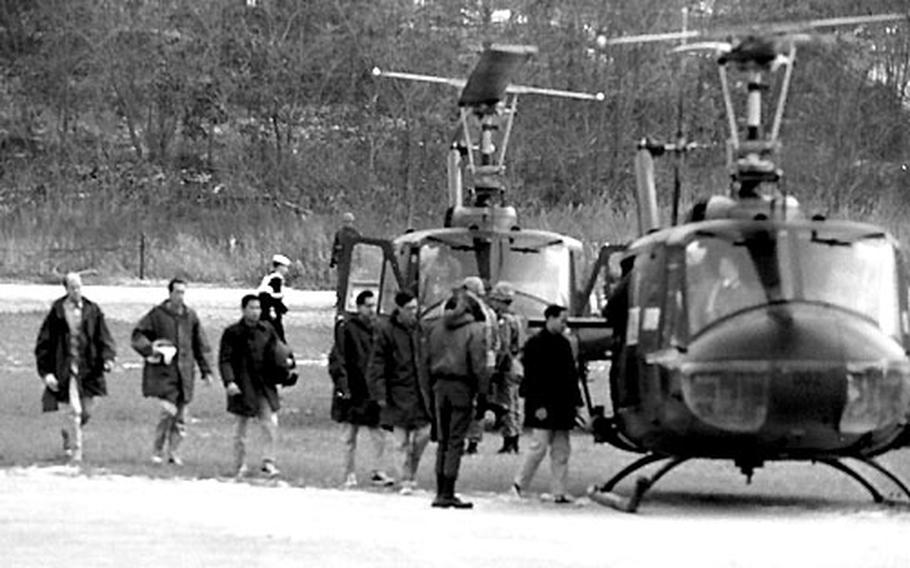 Pueblo crew members board helicopters for a trip to the 121st Evac. Hospital at ASCOM following their release from North Korean captivity.