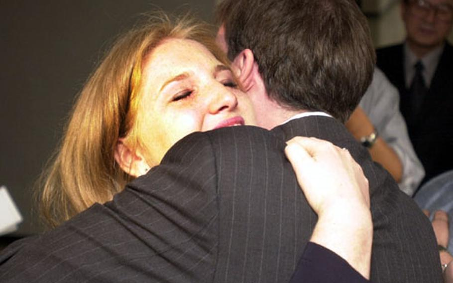 A tearful Kenzi Snider hugs her attorney, Brendan Carr, after a South Korean judge acquitted her of murder charges Tuesday in Seoul.