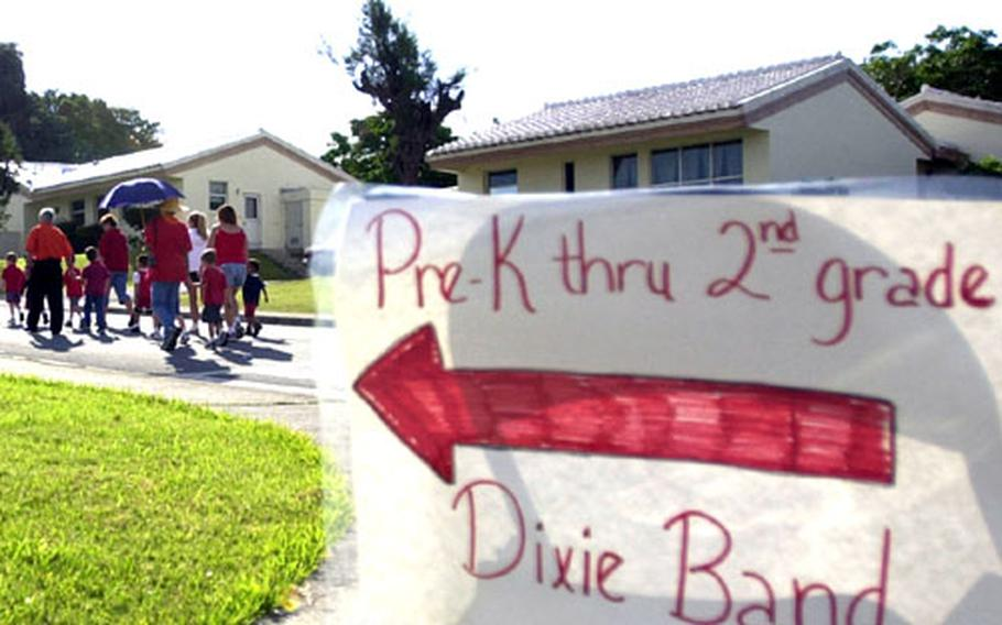 """The sign points the way for younger Kadena Elementary School students during their """"walk away from drugs"""" Thursday, in celebration of Red Ribbon Week."""