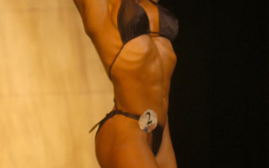 Sylvia Guise, of the middleweight division, beat out two other contestants for the top woman's slot during the first International Natural Bodybuilding and Fitness, U.S. Armed Forces-Europe Natural Bodybuilding Championships held at the Performing Arts Center in Darmstadt, Germany, Saturday.
