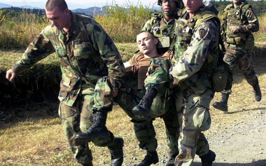 Soldiers performing field training exercises Friday found themselves in a real situation when one of their own, Nebraska-native Spc. Gene Cedar, 25, was bitten by a snake while moving through thick underbrush and grass in the area.