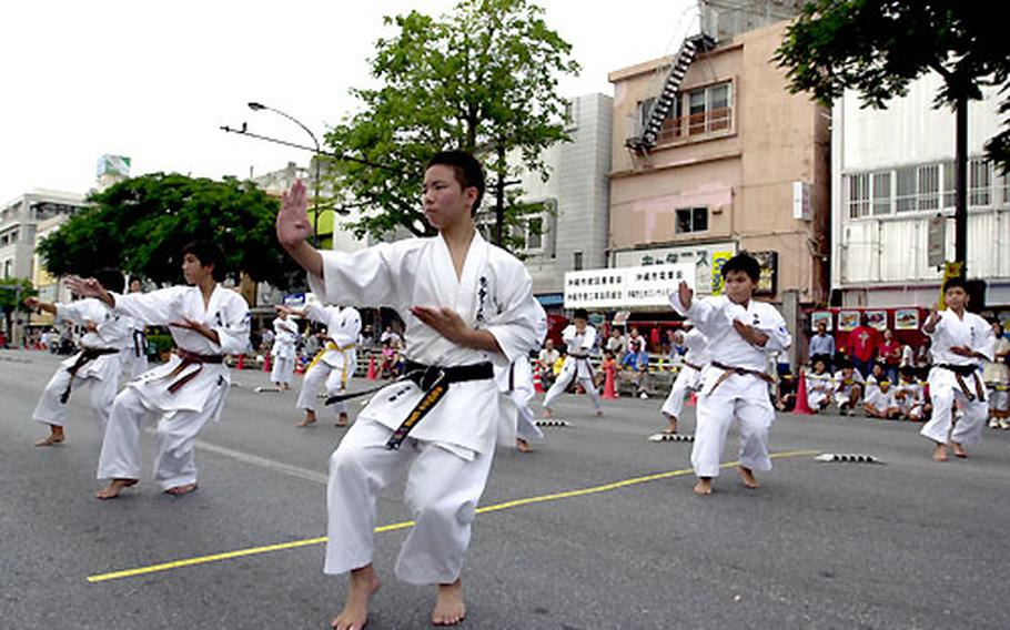 Martial-arts students from a local dojo perform for spectators at the Okinawa International Carnival.