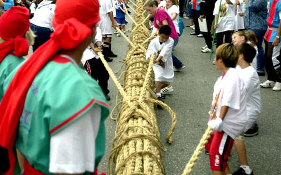 Almost 100 international children - mostly Americans - competed against local Okinawan children in a tug-of-war Saturday at the Okinawa International Carnival. The rope didn't budge for almost five minutes before the International team budged it first, but the Okinawan kids quickly recovered and took the victory.