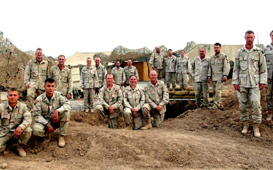Shown here are 18 of the 36 guardsmen from the 200th Engineer Company who are related by blood or marriage. To view a larger version of the photo and caption, .