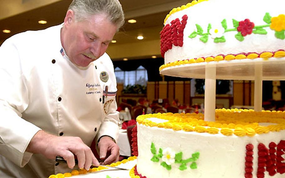 Corporate chef Wolfgang Geckeler smooths out the icing on the ceremonial birthday cake before a Marine Corps Ball at the Butler Officer's Club on Monday. The club is hosting 19 of the 46 birthday balls on Okinawa.