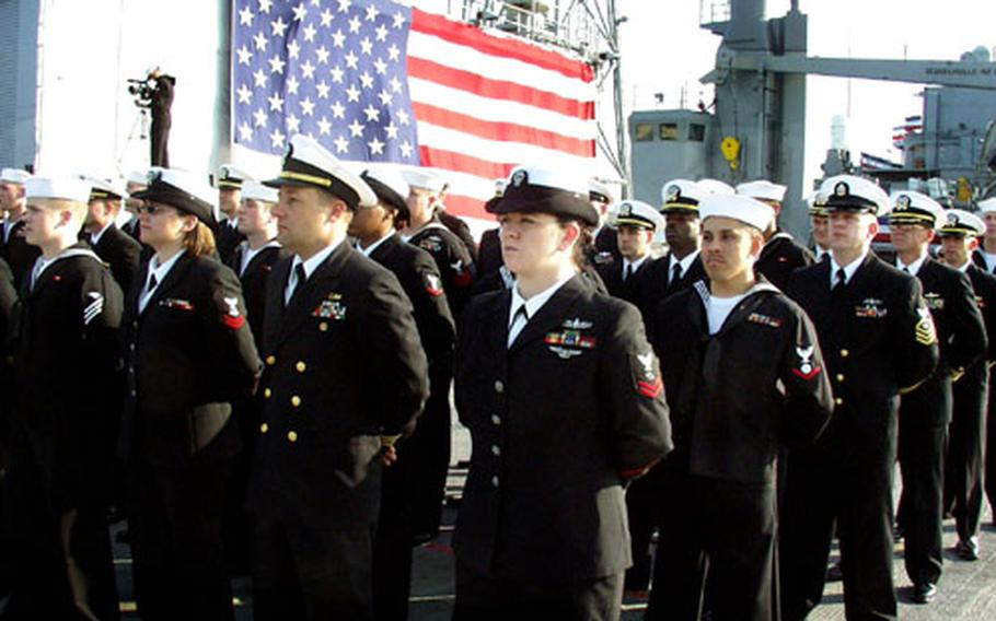 Sailors aboard the USS La Salle observe the change-of-command ceremony.