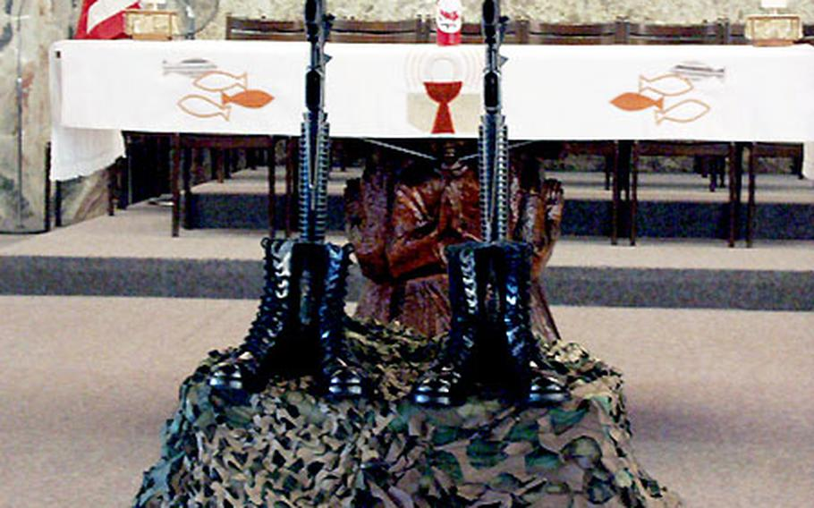 The boots and berets of two paratroops from the 173rd Airborne Brigade were set before the base chapel altar Wednesday for a memorial service at Caserma Ederle in Vicenza, Italy. First Lt. David R. Bernstein and Pfc. John D. Hart were killed Oct. 18 in an ambush in Iraq.
