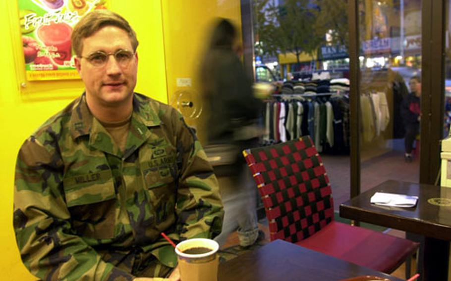 Capt. Dan Miller, a recovering alcoholic, enjoys his newest favorite beverage, coffee, in Itaewon.