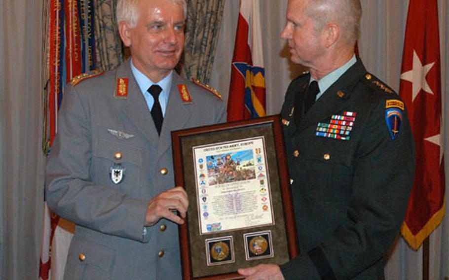 German Lt. Gen. Gert Gudera, left, receives a certificate of appreciation from U.S. Army Europe commander Gen. B.B. Bell in Heidelberg, Germany, Wednesday.