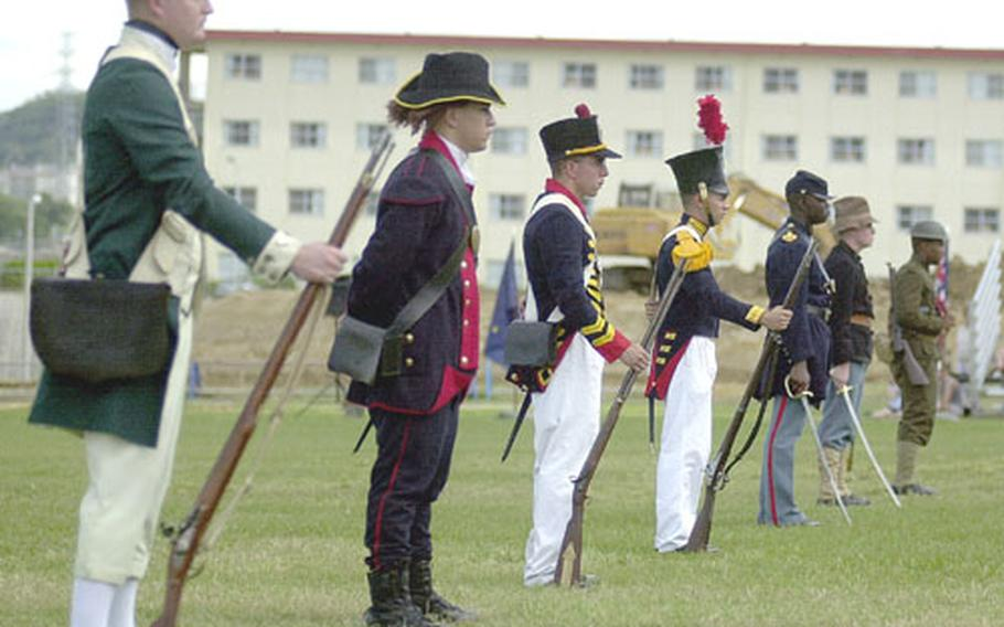 Marines dressed in period uniforms stand on display during the uniform pageant and cake cutting ceremony on Camp Foster celebrating the 228th birthday of the Marine Corps.