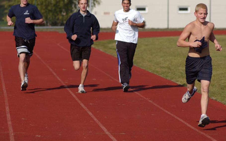 From left, Mike Boyd, Brandon Rech, Chris Doorbal and Chris Barbe run some laps around the track during a recent gym class at Ramstein High School in Germany.