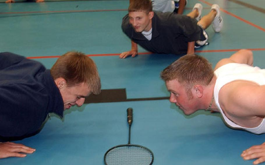 Push-ups and crunches along with stretching, cardiovascular exercises and various sports make up a typical gym class at Ramstein High School in Germany.