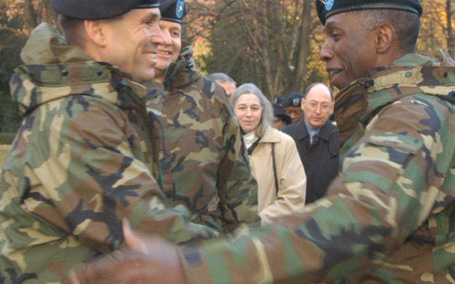 Maj. Gen. John Batiste, left, commander of the 1st Infantry Division, welcomes Lt. Gen. William Ward to U.S. Army Europe following a ceremony Friday at Campbell Barracks in Heidelberg, Germany.