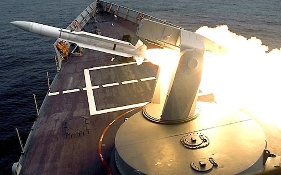 A standard SM-1 surface-to-air missile is launched from the forward missile rail of the frigate USS George Philip during a 2002 training exercise off the California coast.