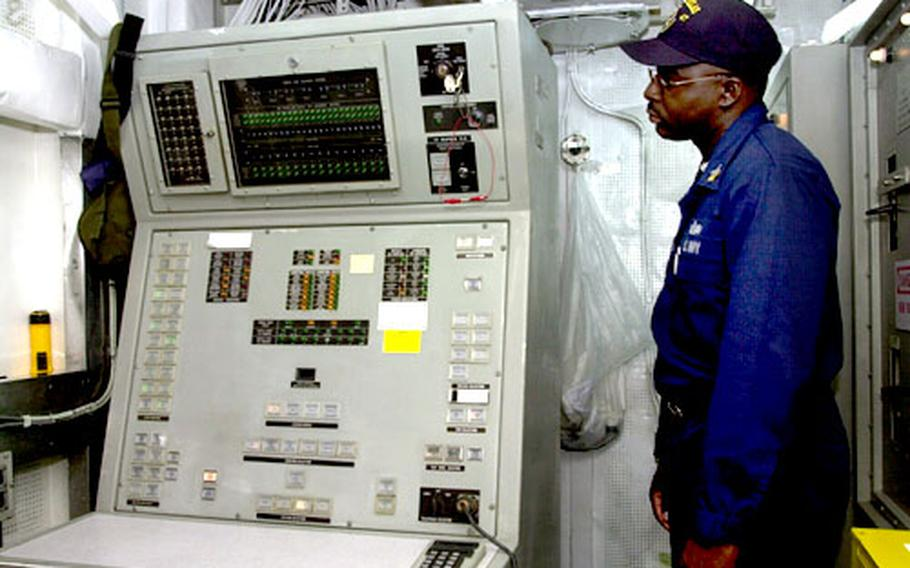 Petty Officer 1st Class Julian Maxwell, leading petty officer for the combat and guns division aboard the guided-missile frigate USS Nicholas, looks at the controls that launch the SM-1. The Navy is removing guided-missile launchers from all frigates by 2010.