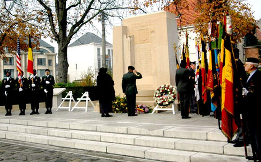 Brenda Schoonover, the American chargé d'affaires to the Kingdom of Belgium, lays a wreath at a monument to U.S. soldiers from the 37th and 91st divisions, which liberated Oudenaarde, Belgium, in November 1918.