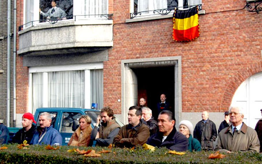 Residents of Oudenaarde watch a Veterans Day ceremony at a monument to American soldiers who helped liberate the town.