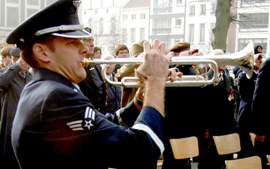 Senior Airman Shawn Ford of the U.S. Air Forces in Europe Band plays taps at the ceremony.