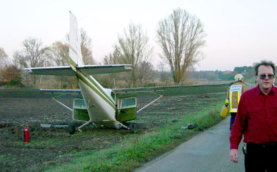 A plane rests in a field just outside the perimeter of Coleman Barracks in Mannheim, Germany. A student pilot misjudged a takeoff Monday that left the Cessna C-172 Skyhawk nose down in the field. The pilot had minor injuries.