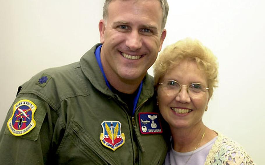 Lt. Col. David Landfair, commander of the 390th Intelligence Squadron on Kadena Air Base, Okinawa, poses Monday with his first-grade teacher, Ellie Schmidt, who now is a counselor at Kadena Middle School.