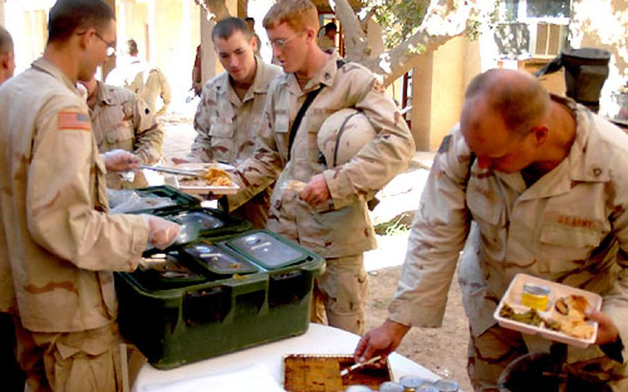 """Soldiers dine """"al fresco"""" at Forward Operating Base Eagle in Iraq. The chow was being served to members of the 1st Battalion, 8th Infantry Regiment, 4th Infantry Division."""