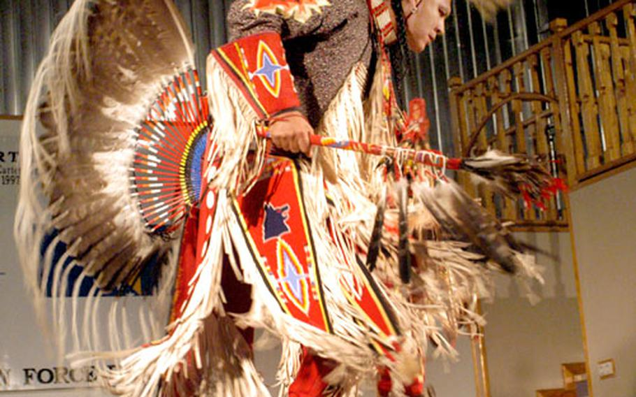 Clad in colorful regalia, Patrick Moore, an American Indian from Oklahoma, dances during the show at Camp McGovern, Bosnia and Herzegovina Wednesday evening.