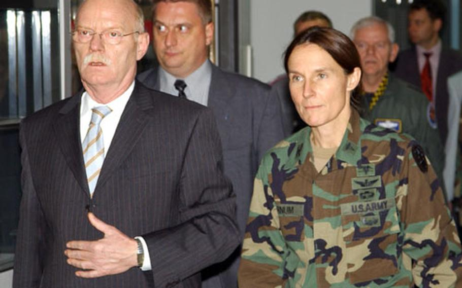 German minister of defense Dr. Peter Struck is escorted by Col. Rhonda Cornum Wednesday during his visit to injured servicemembers at Landstuhl Army Medical Center.
