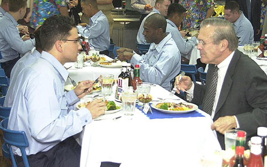 (left to right) Petty Officer 3rd Class Brandon Fraiser said he and Defense Secretary Donald Rumsfeld discussed Cold War politics during lunch onboard USS Blue Ridge Saturday.