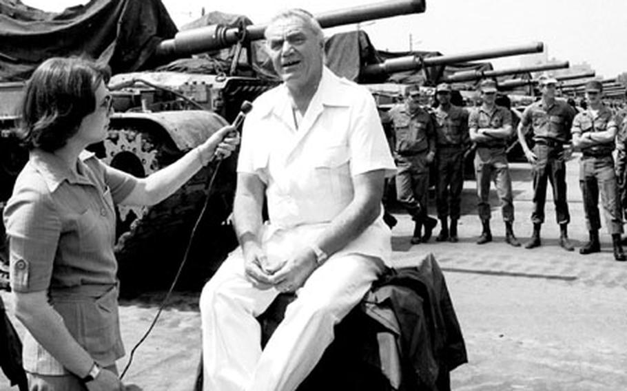 Actor Ernest Borgnine sits down for a TV interview at Mainz, Germany, in June, 1979.