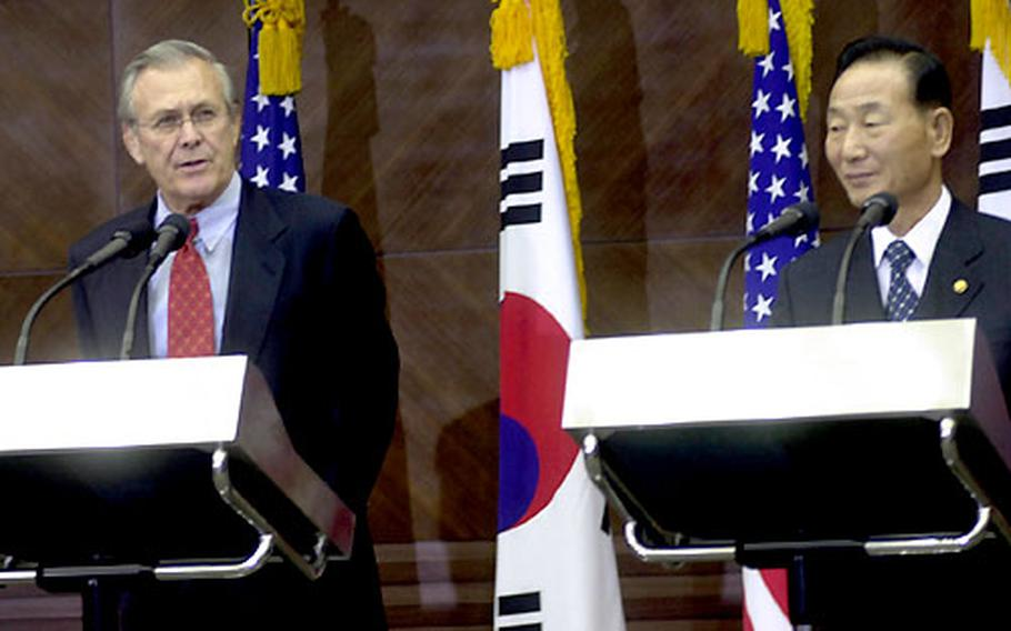 U.S. Defense Secretary Donald Rumsfeld, left, and South Korean Defense Minister Cho Young-kil said Monday they will continue work to realign U.S. forces in South Korea.