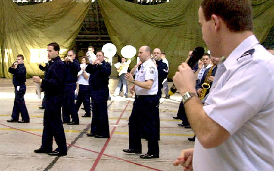 Capt. Jeffrey Warner, commander of the U.S. Air Force Band of the Pacific-Elmendorf, leads band members through drill steps during a rehearsal at Yokota Air Base, Japan, on Monday.