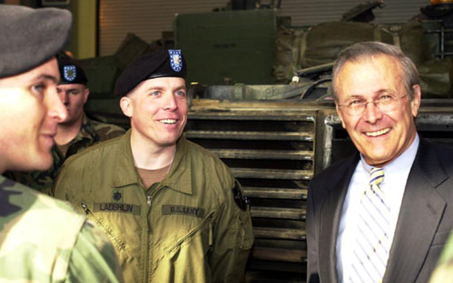 Secretary of Defense Donald Rumsfeld tours the 1st Battalion, 72nd Armor Regiment motor pool at Camp Casey.