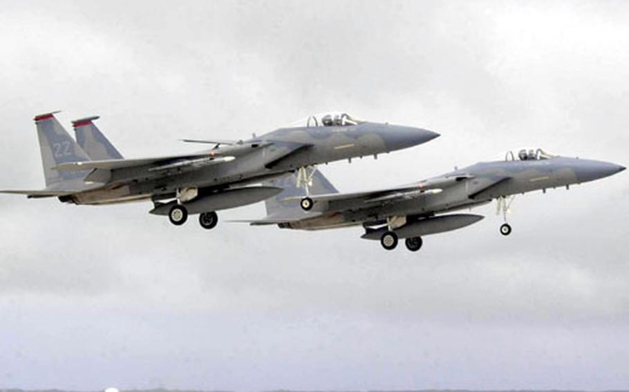 A pair of F-15 aircraft from the 67th Fighter Squadron, Kadena Air Base, Japan, return to Andersen Air Force Base, Guam, after a mission during exercise Cope North 04.